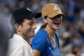 Ashton Kutcher and Mila Kunis Have a Baseball Date Night as Demi Moore Claims He Cheated