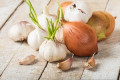 Eating raw onions and garlic every day 'may reduce a woman's risk of getting breast cancer by 67%'