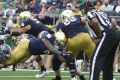 No. 10 Notre Dame forces five turnovers, eight sacks to push past No. 18 Virginia