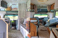 Before-and-after photos show how a woman transforms vintage RVs into chic vans fit for glamping