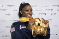 After record world medal haul, Biles face of 2020 Olympics