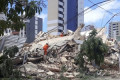 High-rise apartment building in upscale Brazil neighbourhood is latest to collapse without warning