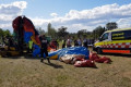 Children injured as strong winds flip jumping castle
