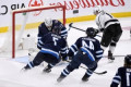Jonathan Quick's solid play lifts Los Angeles Kings over Winnipeg Jets 3-2