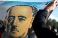Opening new chapter, Spain exhumes Gen. Franco's remains