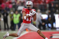 Dobbins, Young, No. 3 Ohio State roll No. 13 Badgers 38-7