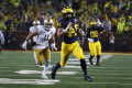 No. 19 Michigan routs No. 8 Notre Dame 45-14 in rain