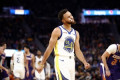 Warriors' Stephen Curry suffers apparent wrist injury, won't return vs. Suns