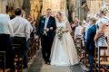 Bride who uses wheelchair shocks groom by walking down aisle on wedding day