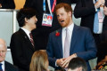 Prince Harry joins Japan's Crown Prince Akishino in the stands at Rugby World Cup final while Meghan Markle cheers at home 'with baby Archie in a replica strip onesie'