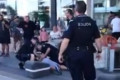 Two men attack Kurdish protesters during Gold Coast march