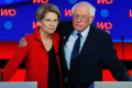 Elizabeth Warren and Bernie Sanders take swipes at billionaire Michael Bloomberg in response to his potential presidential bid