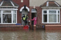 Torrential rain in England kills 1; floods streets