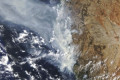 Australian wildfires injure firefighters and destroy homes