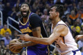 Lakers pull away with late 3-pointers to beat Suns 123-115