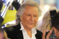 Canadian fashion designer Peter Nygard says he is too ill to travel to Bahamas for jail sentence
