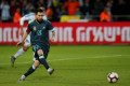 Messi's late penalty gives Argentina 2-2 draw with Uruguay