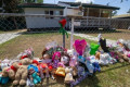 Mum charged after young daughters die in 'extreme heat'