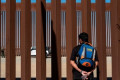 Trump's border wall hangs over spending talks