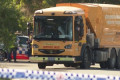 Sydney woman dies after being struck by garbage truck