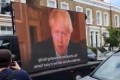Pranksters are playing Boris Johnson's 'stay at home' address outside Dominic Cummings' home on a huge screen