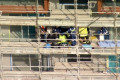 Woman falls three storeys from scaffolding at Sydney worksite