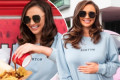 Pregnant Charlotte Dawson cradles her bump in a mother jumper dress