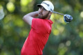 Wolff charges into lead at U.S. Open after 65