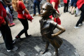 Fearless Girl statue in NYC dressed in lace collar to honor Ruth Bader Ginsburg