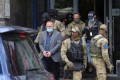 EU police raid Kosovo war veterans' office, detain leader