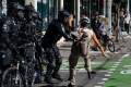 Seattle Protester Whacks Police Officer With Metal Baseball Bat in Viral Video