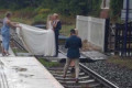 Bride and groom posing for pictures on train track among 5,000 trespassing incidents on the railways