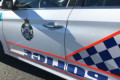 Brisbane primary school staff member charged with historic child sex offences